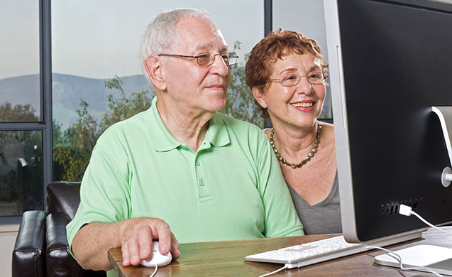 Senior-Couple-Using-Computer
